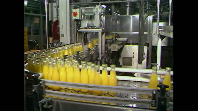 glass bottles of orange drink on production line; 1984 - carbonated stock videos & royalty-free footage