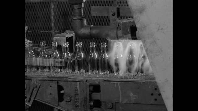 glass bottles on production line in factory; 1956 - production line worker stock videos & royalty-free footage