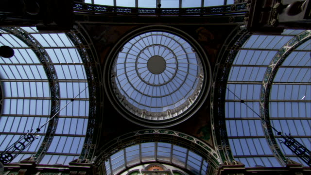a glass ceiling hangs over the shopping arcade in the victoria quarter in leeds. available in hd. - leeds stock videos & royalty-free footage