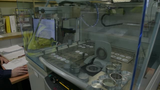 Glass discs of lithium samples are analysed in an automated machine in the laboratory at a Talison Lithium Ltd site a joint venture between Tianqi...