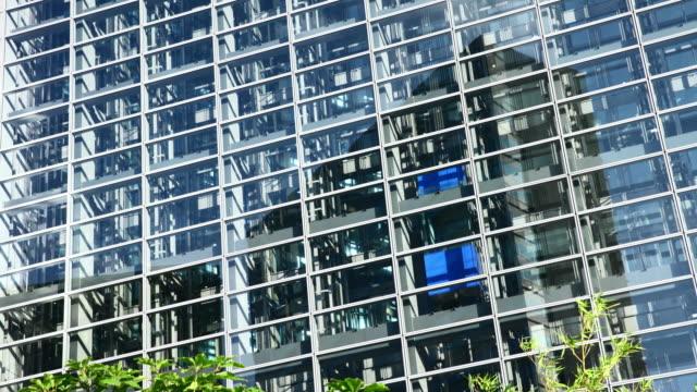 glass elevators in a skyscraper - establishing shot stock videos & royalty-free footage