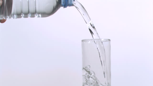 glass filled in super slow motion with water - water bottle stock videos & royalty-free footage