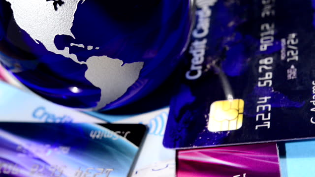 glass globe and contactless credit cards - credit card stock videos & royalty-free footage