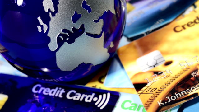 glass globe and contactless credit cards - tap to pay stock videos & royalty-free footage