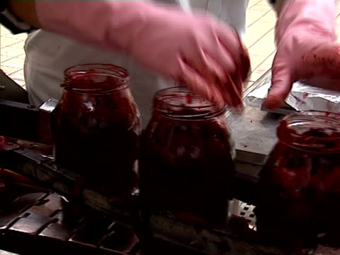 Glass jar with beetroot on conveyor line
