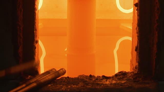A glass melting cauldron shot glowing orange