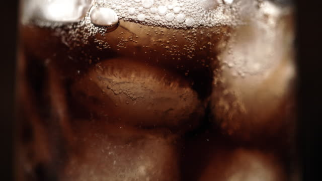 slo mo cu glass of a soft drink with ice - carbonated stock videos & royalty-free footage