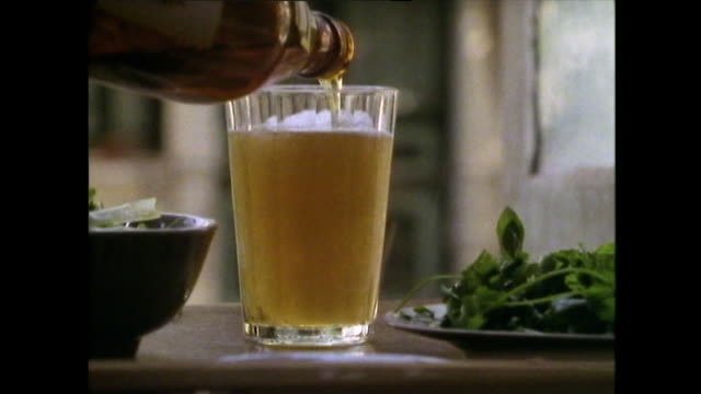 cu glass of alcohol being poured from bottle in hanoi; 1989 - beer bottle stock videos & royalty-free footage