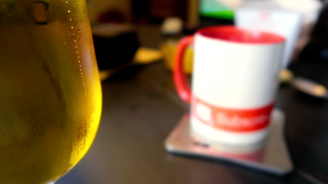 glass of beer with little bubbles, close up, on the table at home - subscribe stock videos and b-roll footage