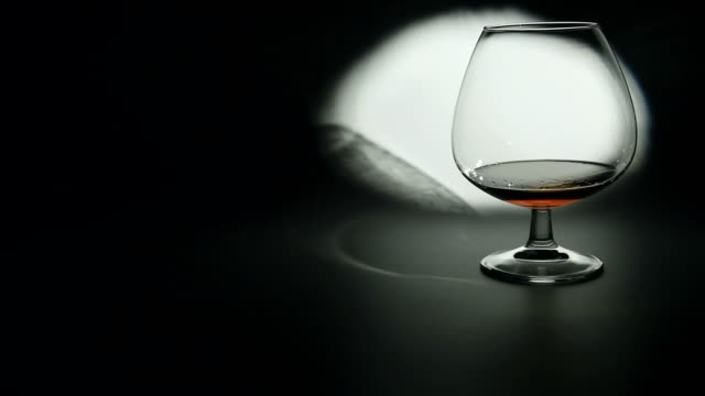 glass of brandy - brandy snifter stock videos and b-roll footage