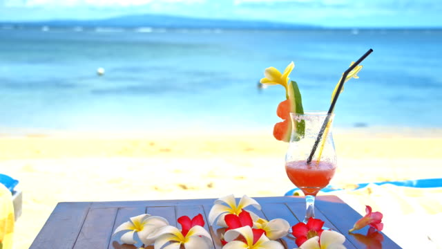 ms glass of cocktail on balinese beach - tropical cocktail stock videos & royalty-free footage