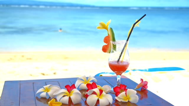 ms glass of cocktail on the beach - tropical cocktail stock videos & royalty-free footage