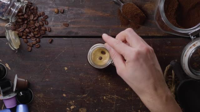 ein glas espresso auf einem holztisch - table top view stock-videos und b-roll-filmmaterial