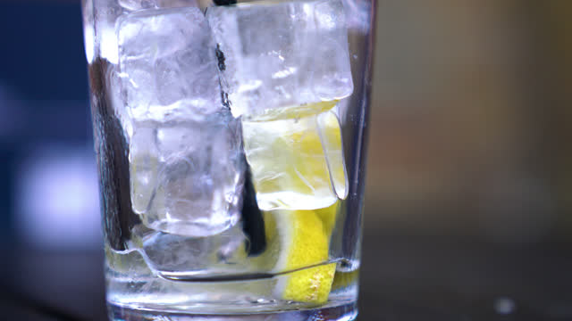 glass of ice filled drink - citrus fruit stock videos & royalty-free footage
