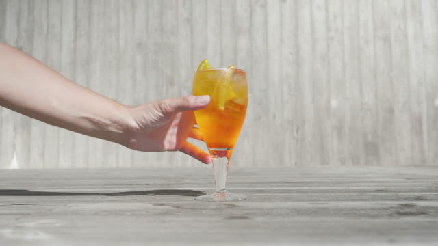 glass of orange spritz cocktail - gripping stock videos and b-roll footage