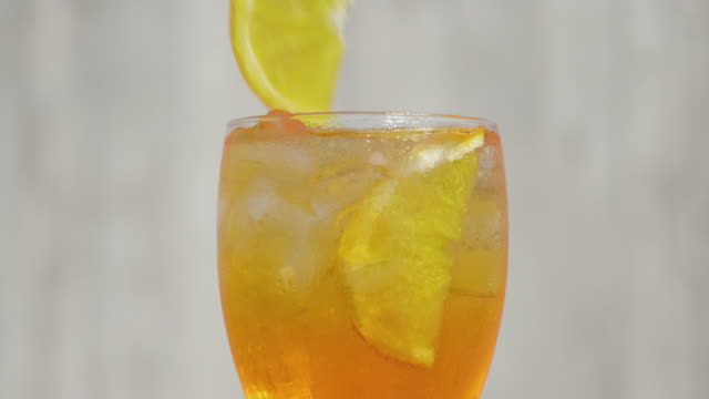 glass of orange spritz cocktail - cocktail stock videos & royalty-free footage