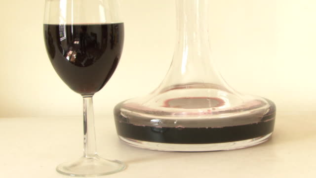glass of red wine and carafe - decanter stock videos and b-roll footage