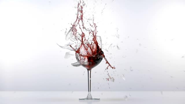 glass of red wine explode - uva video stock e b–roll