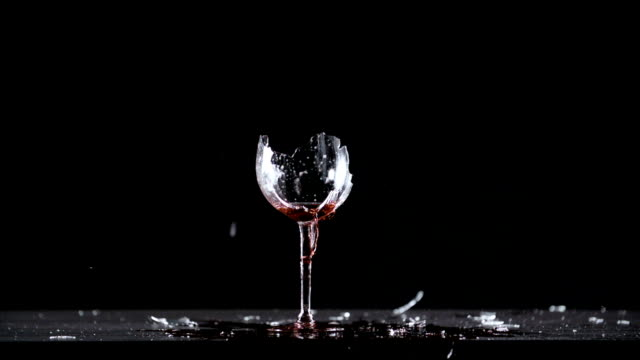 Glass of red wine explode