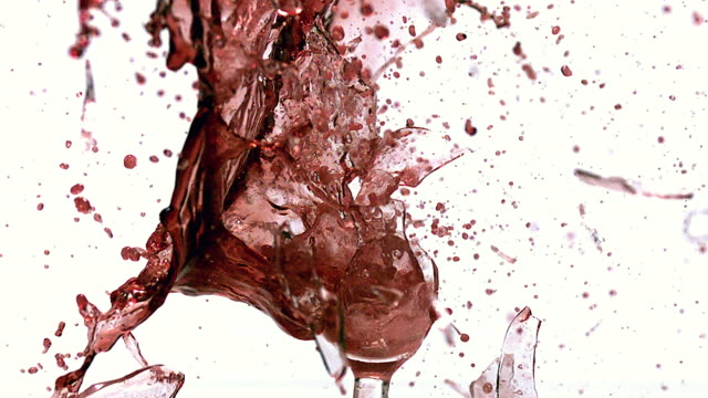 cu slo mo glass of red wine exploding and splashing / vieux pont, normandy, france  - ワイングラス点の映像素材/bロール
