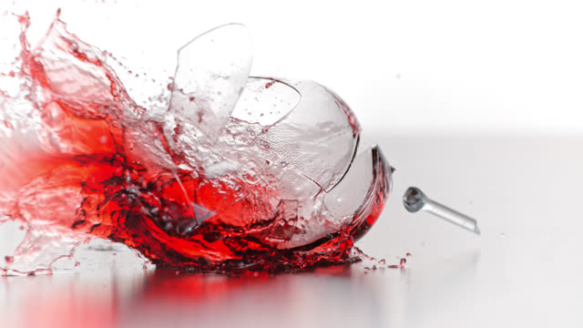 slo mo of glass of red wine smashing into smithereens - wine glass stock videos and b-roll footage