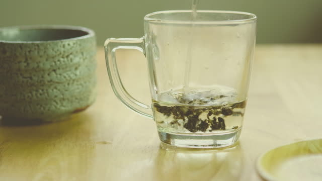 glass of tea - chinese tea cup stock videos and b-roll footage