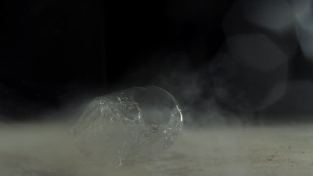 Glass of water fell on the floor and water splashing, slow motion-close up