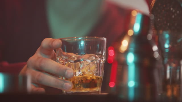 glass of whiskey on the bar counter 4k - drinking glass stock videos & royalty-free footage