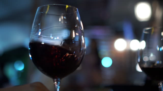 glass of wine in bar (close up) - dark stock videos & royalty-free footage