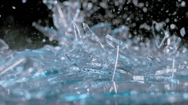 slo mo ld glass shards falling onto the surface - fragility stock videos & royalty-free footage