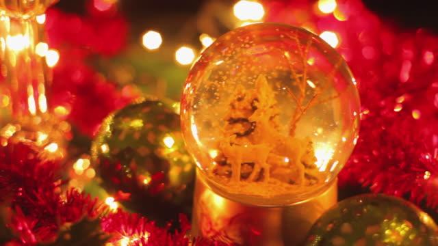 CU PAN Glass snowglobe with Christmas tree and deer / London, United Kingdom