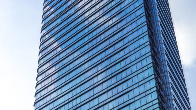 glass wall of modern buildings in midtown of modern city time lapse