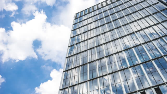 glass wall of modern buildings in midtown of modern city time lapse - office block exterior stock videos & royalty-free footage