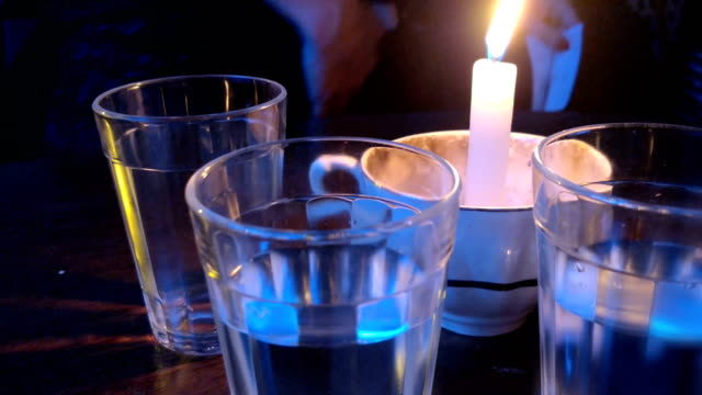glasses and a bottle of candlelight - cachaça stock videos & royalty-free footage