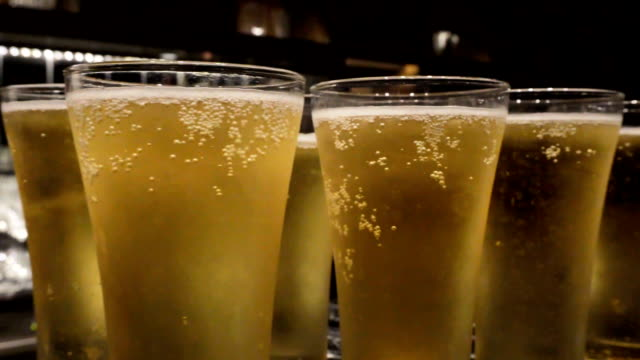 glasses of beer in slide movement - lager stock videos & royalty-free footage
