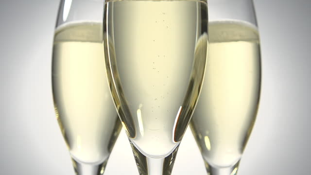 Glasses of champagne against White Background, Real Time