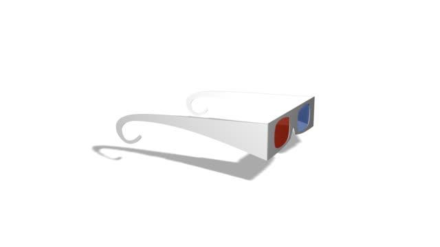 vídeos de stock, filmes e b-roll de 3 d óculos girando sobre fundo branco - óculos de terceira dimensão