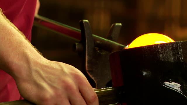 CU Glassmaker Forming Hot Glass in a Block