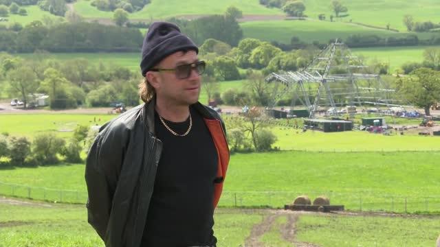 damon albarn interview; england: somerset: pilton: worthy farm: ext damon albarn interview sot. - on streaming music, musicians, music industry,... - stream stock videos & royalty-free footage