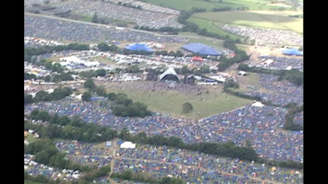 stockvideo's en b-roll-footage met new system aims to beat ticket touts; lib air view glastonbury festival lib sequence glastonbury festival and festival goers on campsite - festivalganger