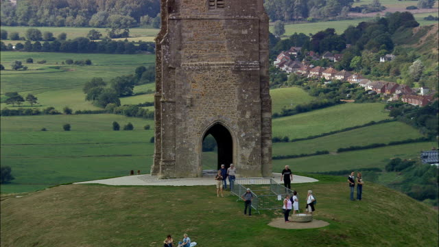 glastonbury tor  - aerial view - england, somerset, mendip district, united kingdom - somerset stock videos & royalty-free footage