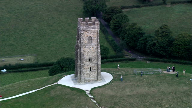 glastonbury tor  - aerial view - england, somerset, mendip district, united kingdom - somerset england stock videos & royalty-free footage