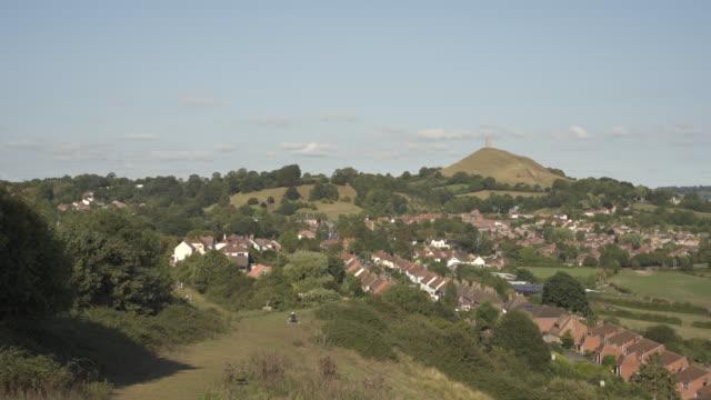 glastonbury tor from wearyall hill, somerset, uk - glastonbury tor stock videos & royalty-free footage