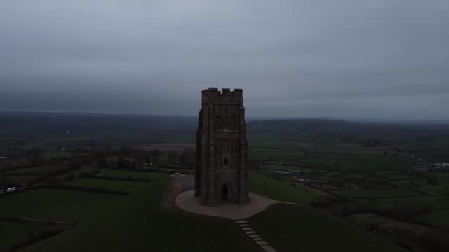 glastonbury tor general views; england: glastonbury: glastonbury tor: ext time lapse clouds passing over glastonbury tor / point of view through tor... - rock formation stock videos & royalty-free footage
