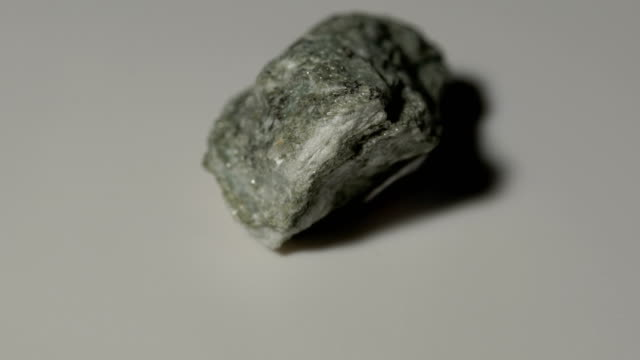 glaucophane schist mineral sample in rotation with white background - schist stock videos and b-roll footage