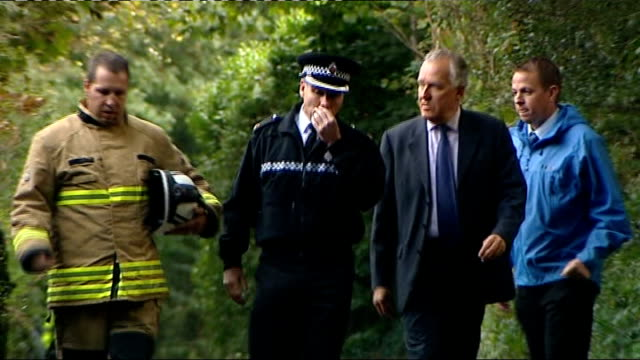 general views / press conference / peter hain interview wales pontardawe ext rescue workers along in back of truck / ambulance along / peter hain mp... - emergency services vehicle stock videos and b-roll footage
