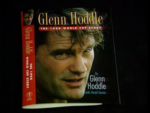 glen hoddle autobiography; itn england: london: int cover of glenn hoddle's 'the 1998 world cup story' zoom in - autobiography stock videos & royalty-free footage
