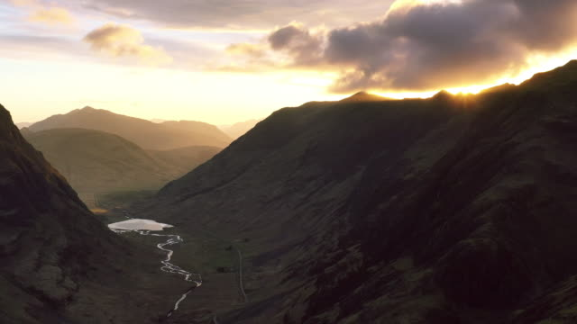 glencoe valley in scottish highlands at dusk - scottish highlands stock videos and b-roll footage