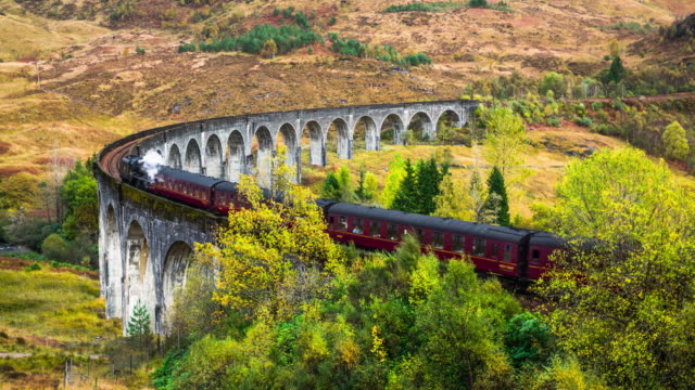 glenfinnan viaduct with a steam train, scotland, uk - locomotive stock videos & royalty-free footage