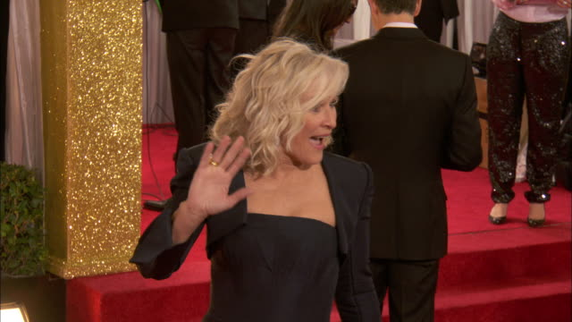 glenn close walking through crowd down the red carpet smiling and waving at beverly hilton hotel - glenn close stock videos & royalty-free footage